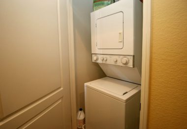 Inside laundry behind closed door (stackable washer/dryer are included).
