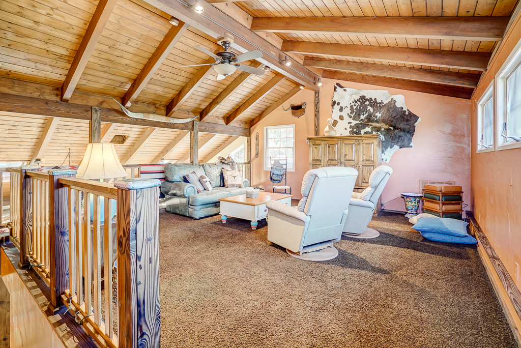 Loft to be used as family room or game room. Wooden cathedral ceiling, newer double pane windows, track lighting and ceiling fan.