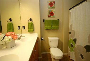 Private master bathroom with dual sinks, tile flooring, and a soaking tub with shower.