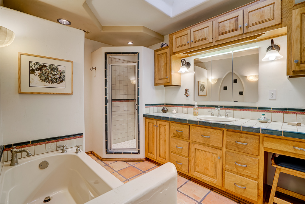Custom master bathroom with homemade tiles, skylight, separate shower, and outlets in two top drawers for blow dryer, curling iron or electric shaver!