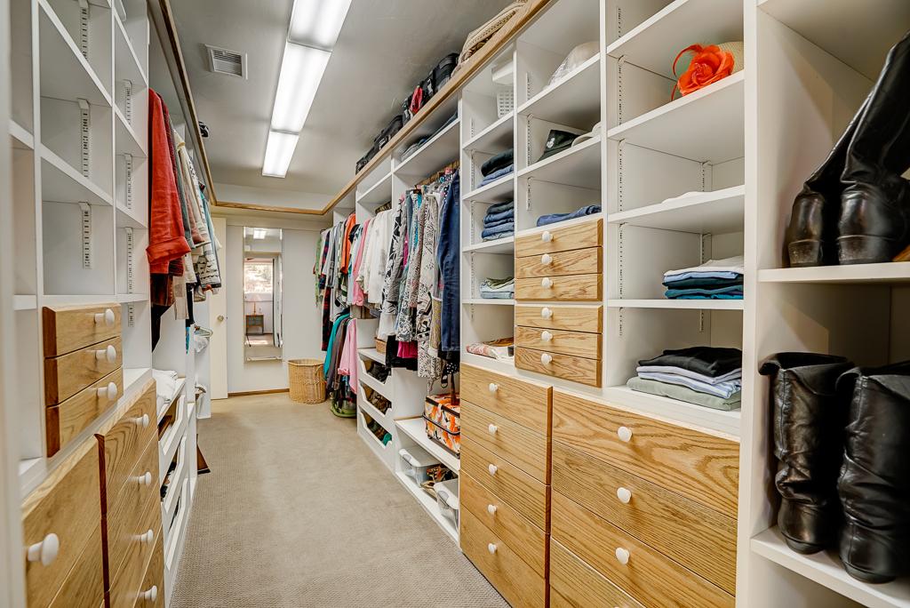 Exquisite master walk-in closet.