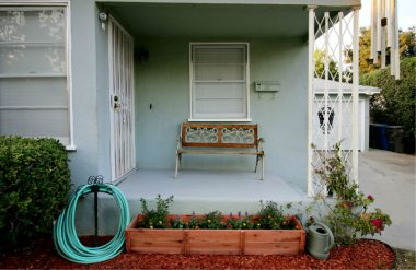 Covered front porch and freshly planted flower box.