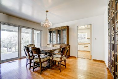 Formal dining room with period mid-century cabinetry.