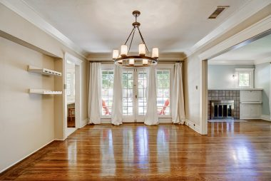 Formal dining room with French doors leading to quaint side patio.