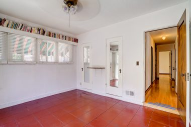 Alternate view of back bedroom with view of hallway and two closets.