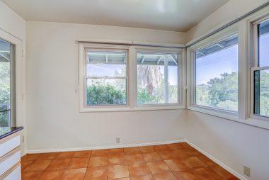 Breakfast nook with corner windows overlooking Riverside.