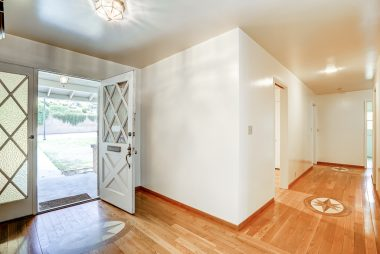 Front entrance, highlighting the gorgeous inlaid hardwood floors leading towards the bedrooms.