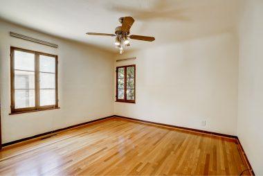 Front bedroom with gorgeous original hardwood floors.