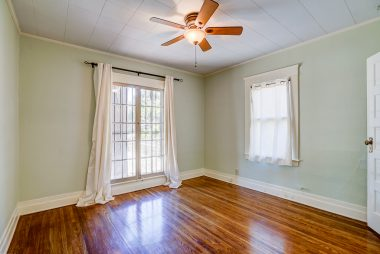 Front bedroom with gorgeous original hardwood floors.