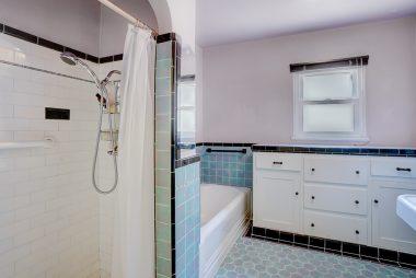 Alternate view of hallway bathroom highlighting tub and separate shower.