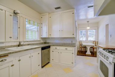 Charming kitchen with stone counter tops and adjoining breakfast nook