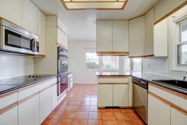 Kitchen and breakfast nook with corner windows overlooking Riverside.