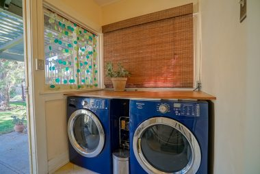 Indoor laundry room -- washer and dryer stay.