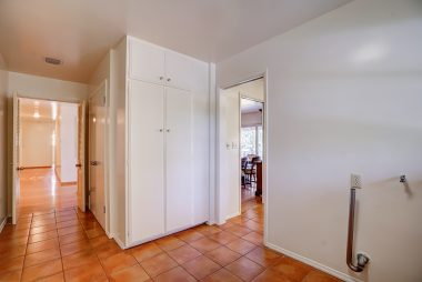 Separate laundry room just off the kitchen with lots of cabinetry.
