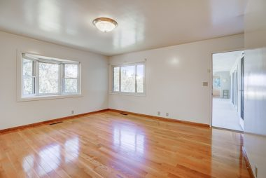 Master suite with hardwood floors and separate entrance to back patio.