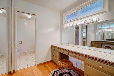 Master walk-thru closet area with built-in make-up vanity.
