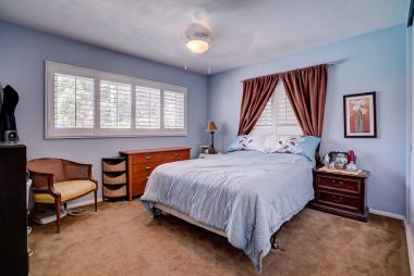 Three bedrooms, all with large closet space, double pane windows, ceiling fan, and window shutters. This bedroom has a separate entrance from the patio area.