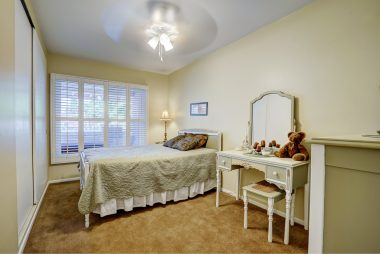 Three bedrooms, all with large closet space, double pane windows, ceiling fan, and window shutters. This bedroom overlooks the backyard.