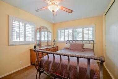 Three bedrooms, all with large closet space, double pane windows, ceiling fan, and window shutters. This one could be used as master due to private doorway into one of the hallway bathrooms.