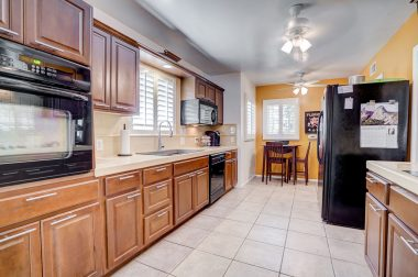 Remodeled kitchen with tile floors, built-in microwave, dishwasher, and corner nook area.