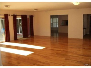 Photo of hardwood floors prior to current homeowner moving in and laying current carpeting.