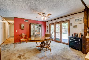 Alternate view of spacious formal dining room with newer French doors to backyard.