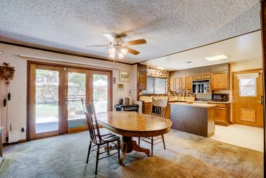 Large formal dining room and kitchen combo with newer French doors to backyard.