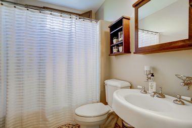 Remodeled bathroom with tile floor.