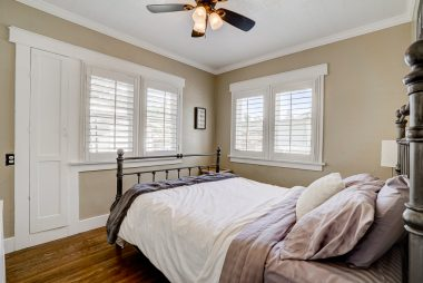 1st of two bedrooms (hardwood floors, ceiling fan, window shutters).