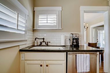 Stone counter tops and dishwasher in remodeled kitchen.
