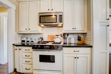 Remodeled kitchen with built-in microwave, tile floor, and stainless steel refrigerator stays too.