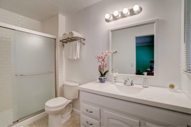 Remodeled master bathroom with easy-access shower.
