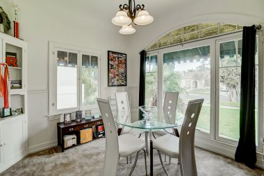 Formal dining room with barrel ceiling and original corner hutch.