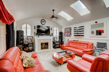 Barrel ceiling, fireplace, original windows, and 3 skylights that really brighten this room.