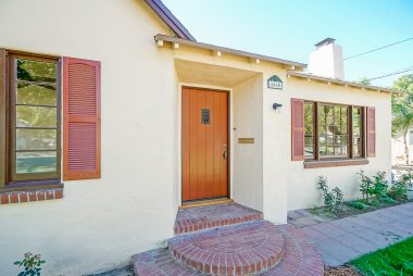 Charming front entrance with original wood front door!