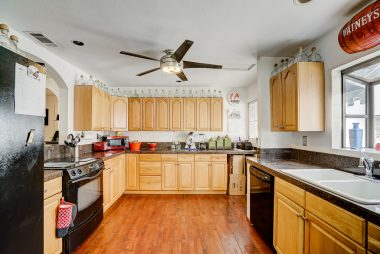 Spacious updated kitchen with granite counter tops, dishwasher, and lots of cabinetry.
