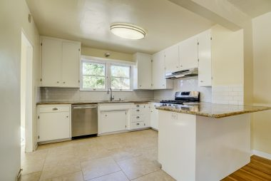 Remodeled kitchen opens up into the formal dining room. with breakfast bar.