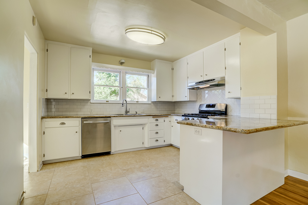Remodeled Kitchen Opens Up Into The Formal Dining Room With Breakfast Bar
