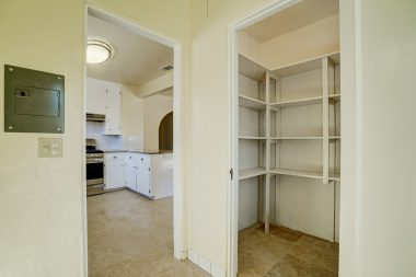 Walk-in pantry and indoor laundry room.