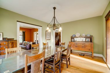 Alternate view of formal dining room with enough wall space for additional sideboards.
