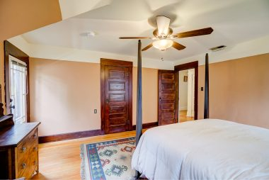 Alternate view of bedroom with ceiling fan. Note that all of the original wood (doors, frames, baseboards) in this bedroom have been refinished back to its original splendor.