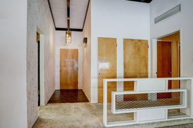 Front door entry with 50's style retro room divider.