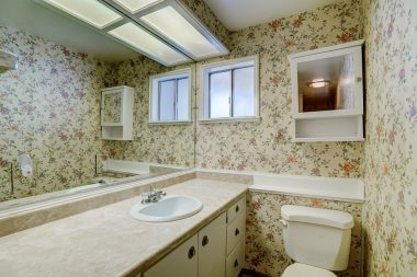 Hallway bathroom with shower in tub, and room for second sink if needed.