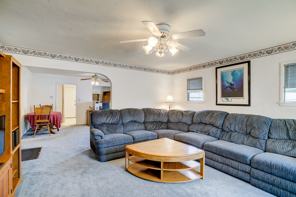 Spacious living room with ceiling fan.