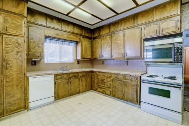 Retro eat-in kitchen with custom-made cabinets, dishwasher, and retro electric stove!