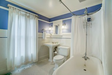 Gorgeous upstairs bathroom with claw foot tub and pedestal sink.