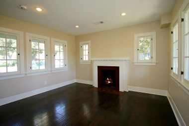 Family room with second fireplace which could also double as dining area. Lots of natural light, along with recessed ceiling lights.