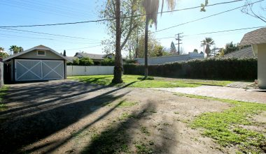 Alternate view of huge backyard with 2-car detached garage and alley access too.