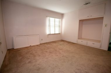 Front bedroom with hardwood floors under carpeting, and large closet (doors can easily be reinstalled).