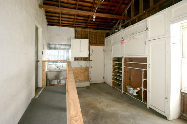 Attached one-car garage with ramp, utility sink, laundry hookups, and lots of built-in shelving, and automatic garage door opener.